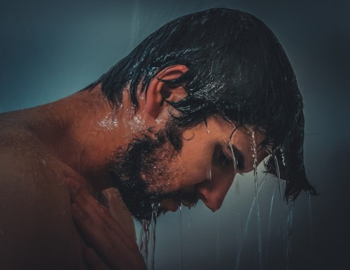 sad man in shower