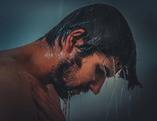 sad man in shower