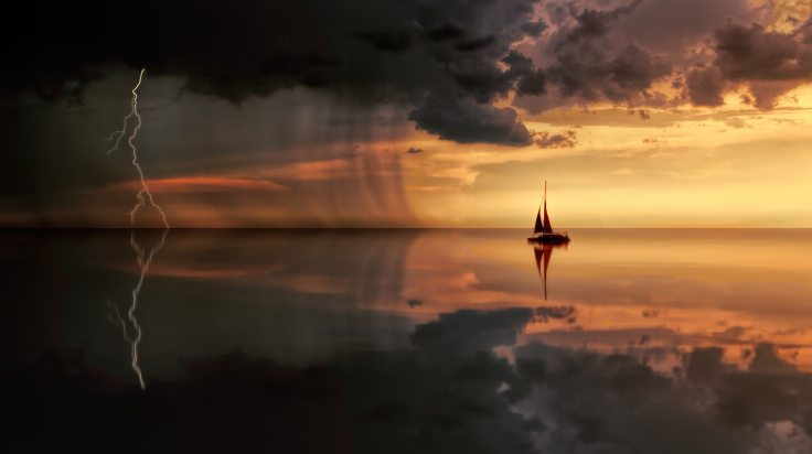 silhouette-photography-of-boat-on-water-during-sunset-1118874