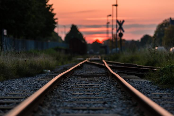 shallow-focus-photography-of-railway-during-sunset-892541