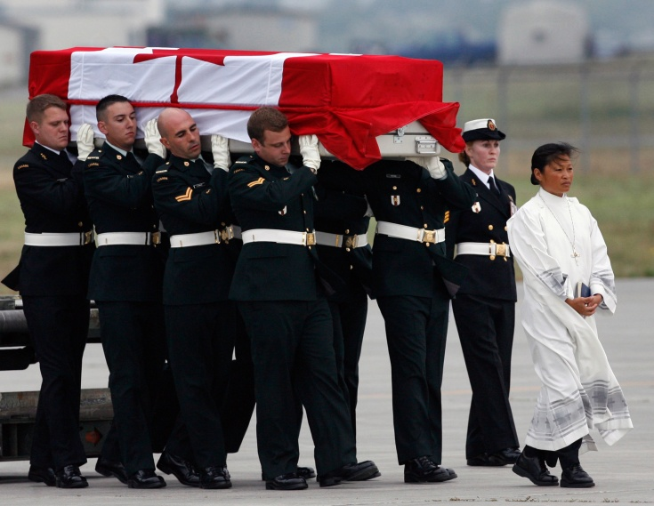 Pallbearers carry the casket of Corporal Andrew James Eykelenboom at CFB Trenton